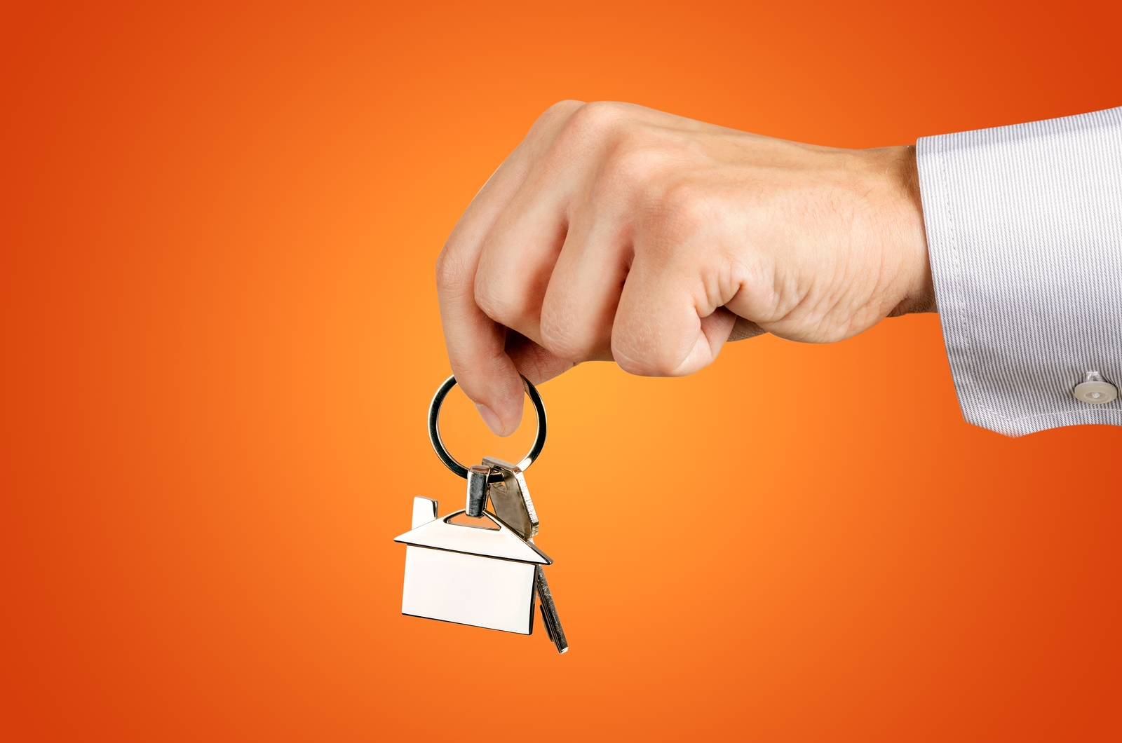 bigstock-Man-Hand-Holding-Keys-With-To-98084807