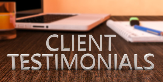 Client Testimonials - letters on wooden desk with laptop computer and a notebook. 3d render illustration. ** Note: Shallow depth of field